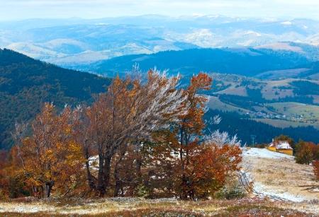 October Carpathian mountain Borghava plateau with first winter snow and autumn colourful foliage