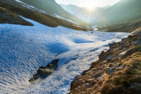Evening mountain stream and sunset (near Timmelsjoch - high alpine road on Italian - Austria border) Stock Photo - 15333059