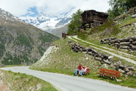 Family (mother with children) walk on summer Alps mountain plateau (Switzerland, near Zermatt) photo
