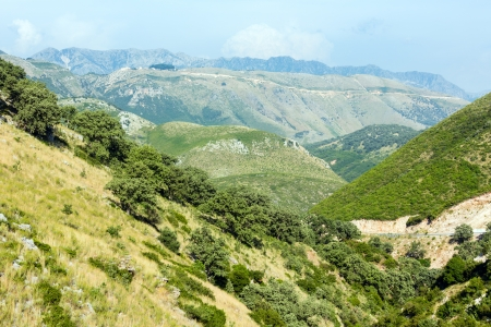 Summer misty Llogara pass view (Albania) photo