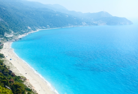 Beautiful summer Lefkada coast beach (Greece, Ionian Sea)  view from up (all peoples unrecognizable) photo