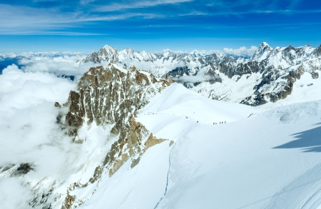 Mont Blanc mountain massif summer landscape (View from Aiguille du Midi Mount,  French.  All people are unrecognizable photo