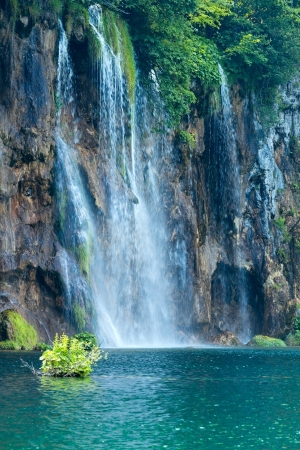 Summer view of large waterfall in Plitvice Lakes National Park (Croatia) photo