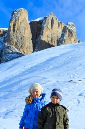 sella: Two children on beautiful winter mountain slope (Sella Pass , Italy). Stock Photo