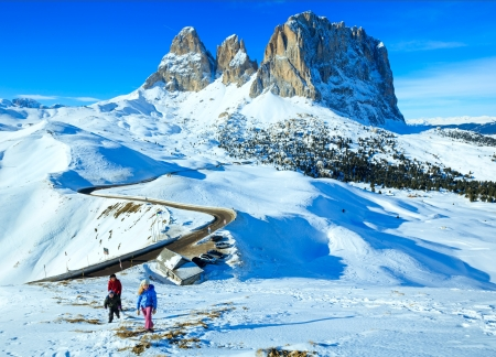 sella: Family on beautiful winter mountain slope (Sella Pass , Italy).