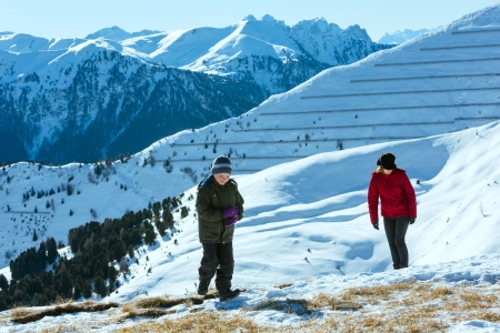 sella: Family walking on winter mountain slope (Sella Pass , Italy). Stock Photo