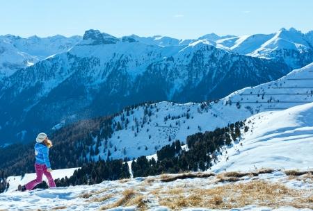 sella: Girl playing on winter mountain slope (Sella Pass , Italy). Stock Photo