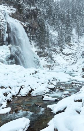 Alps mountain waterfall Krimml (Austria, Tirol) winter view and snowfall. photo