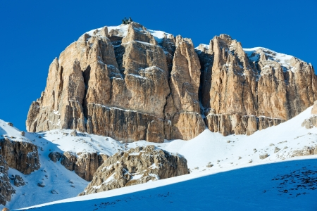 station ski: Beautiful winter mountain view  from Pordoi Pass (pass in the Dolomites in the Alps) with ski station on mount top. Stock Photo