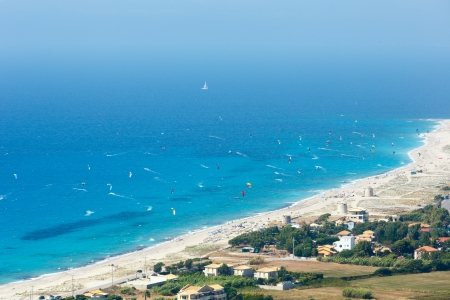 identifiable: Beautiful summer Lefkada coast beach and kiteboarders (Greece, Ionian Sea,  view from up). All people are not identifiable.