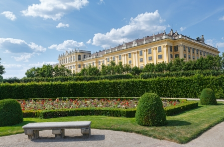 schonbrunn palace: Area before Schonbrunn Palace (build 16-17 century) with blossoming flowers on lawn. Vienna, Austria.