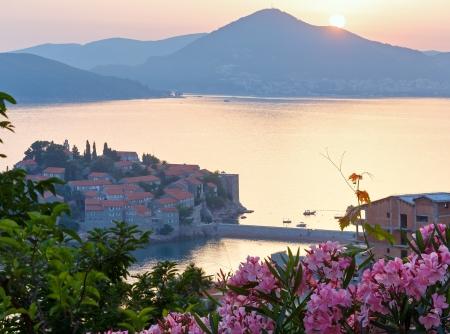 kilometres: The view from the terrace at sunset over  Sveti Stefan sea islet (Montenegro, 6 kilometres southeast of Budva) Stock Photo