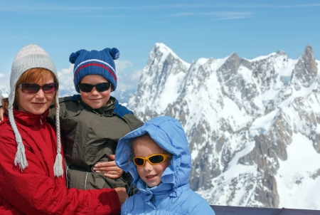Family on observation area and Mont Blanc mountain massif behind (view from Aiguille du Midi Mount,  France ) photo