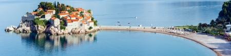 kilometres: The morning view of Sveti Stefan sea islet with beach and town-hotel (Montenegro, 6 kilometres southeast of Budva)