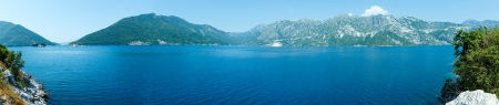 islets: Bay of Kotor summer panorama with two islets off the coast of Perast town (Montenegro) Stock Photo