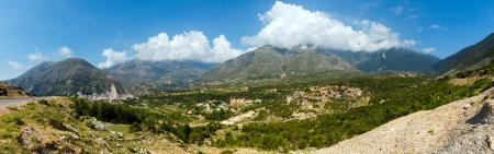 Summer view from Llogara pass on small village on slope (Albania) photo