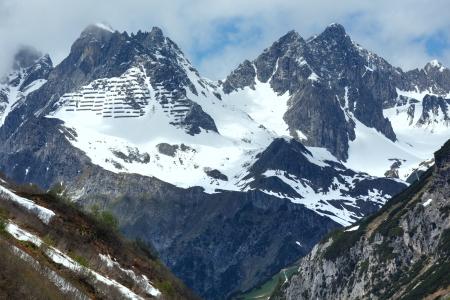 Summer alpine view with snow retention constructions on mountain (Warth, Vorarlberg, Austria). photo