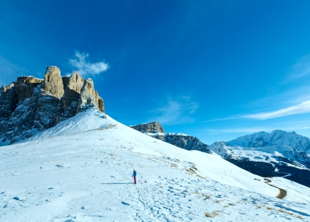 sella: Girl on beautiful winter mountain hill and road (Sella Pass , Italy).