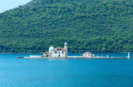 Summer view on  artificial island with  Roman Catholic Church of Our Lady of the Rocks.  Built in 1632y.  (Perast town, Montenegro, Kotors bay) photo