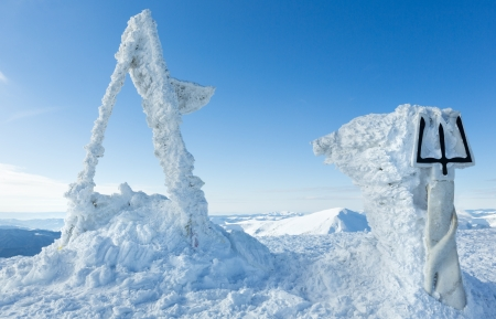 Sunny winter Goverla Mount top with snowy sculptural monument to Ukrainian Tryzub (Carpathian, Ukraine). photo