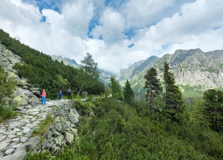 footway: High Tatras summer cloudy mountain view family on pathway   Slovakia, footway between Popradske Pleso and Strebske Pleso  Stock Photo