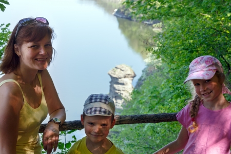 Happy family and Bakota spring view behind ( Khmelnytskyi Oblast, Ukraine) photo