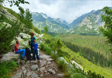 footway: High Tatras summer cloudy mountain view and family on pathway. (Slovakia, footway between Popradske Pleso and Strebske Pleso) Stock Photo