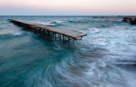 Evening sea storm and ruined pier (Black Sea, Bulgaria). photo