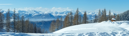 Winter hazy Dachstein mountain massif panorama (Austria). photo