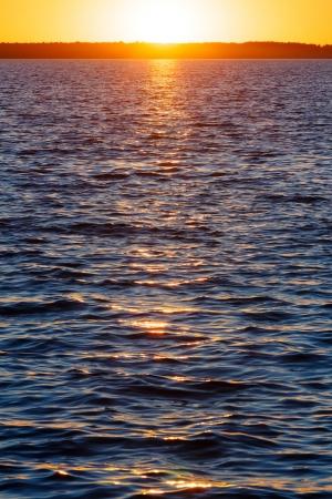 sun track: Sunset and sun track on summer lake surface. Stock Photo