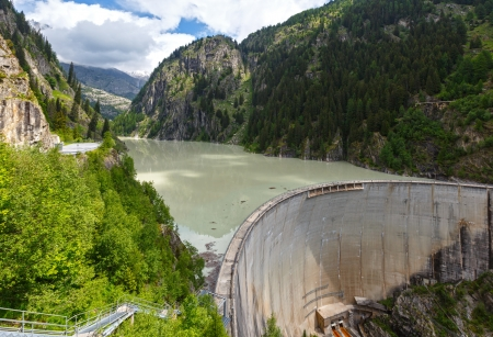 turbid: Summer mountain landscape and dam with turbid water (Alps, Switzerland) Stock Photo