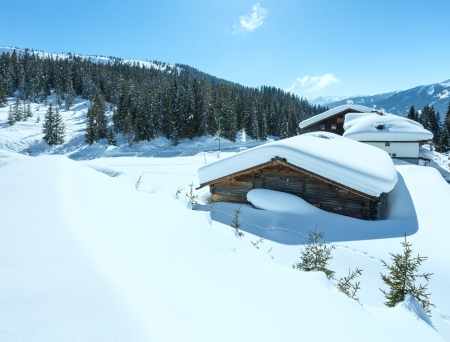 Winter sunny mountain  landscape and wood house on hill (Austria)