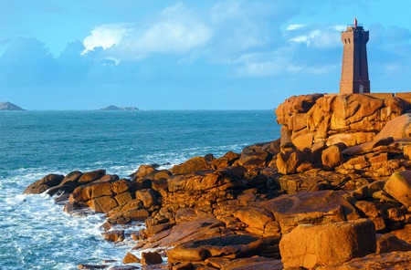 ploumanach: Ploumanach lighthouse sunset view (Perros-Guirec, Brittany, France). The Pink Granite Coast.