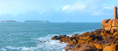 Ploumanach lighthouse (Mean Ruz lighthouse - built in 1946, planned by architect Henry Auffret). Perros-Guirec, Brittany, France. The Pink Granite Coast panorama.