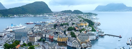 alesund: Alesund town (Norway) summer cloudy view from above. Panorama. All people unrecognizable. Stock Photo