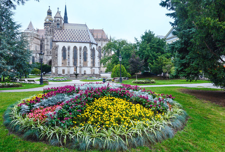 elisabeth: Autumn cloudy Kosice City (Slovakia) landscape with flower bad in front and St. Elisabeth Cathedral (built between 1378 and 1508) behind.