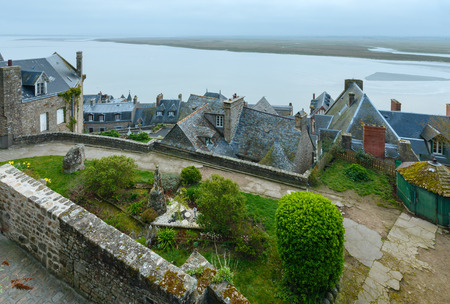 tidal wave: Inside the walls of Mont Saint-Michel. Morning spring sea view.