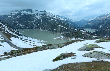 hospice: View from the summit of the pass looking north over the Grimselsee, Grimsel Hospice and Raterichsbodensee (Switzerland, Bernese Alps). Stock Photo