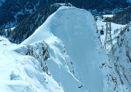 ski lift: Ski lift between two rocks in winter mountain, Tyrol, Austria. Stock Photo