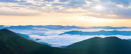 sunrise mountain: Summer cloudy sunrise mountain panorama view (Ukraine, Carpathian Mountains). Two shots stitch image. Stock Photo