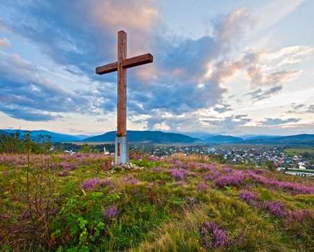 foothills: Summer evening country foothills view with heather flowers and wooden cross (Lviv Oblast, Ukraine) .