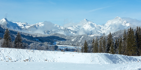 winter: Winter mountain country landscape with fir trees (Heiterwang outskirts, Austria, Tirol) Stock Photo