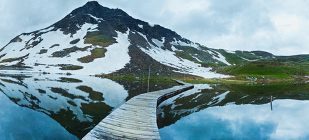 footway: Alps mountains tranquil summer panorama (planked footway across the lake  near Grossglockner High Alpine Road).