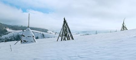 forefront: Winter mountain panorama with  haystack on a forefront (Slavske Village, Lviv Region, Ukraine) Stock Photo