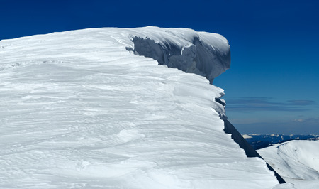 overhang: Winter mountain top with fairy overhang snow cap Stock Photo