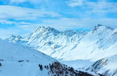 skipiste: Morning winter Silvretta Alps landscape with ski run and ski lift (Tyrol, Austria). All skiers are unrecognizable.