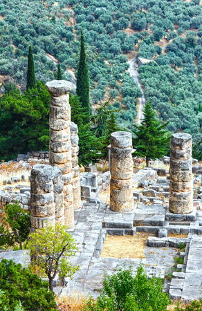 excavations: Excavations of the ancient Delphi city along the slope of Mount Parnassus(Greece). The remaining columns of the Temple of Apollo.