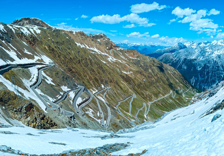 no pase: Summer Stelvio pass top with alpine road and snow on slope (Italy)