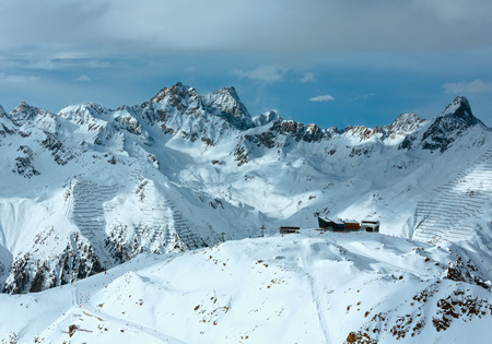 skiers: Winter Silvretta Alps ( Tyrol, Austria) landscape and ski lift on slope. All skiers are unrecognizable.