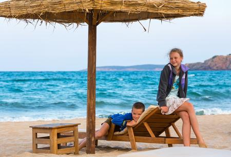 bulgaria girl: Children on wooden beach bed. Summer vacation. Bulgaria.